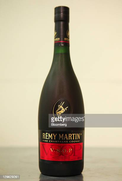 A bottle of Remy Martin cognac produced by Remy Cointreau SA is arranged for a photograph in London UK on Tuesday Oct 18 2011 UK shopprice growth was...