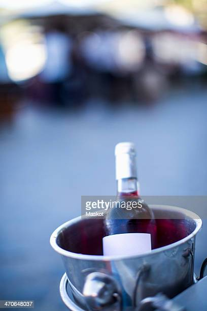 Bottle of rose wine in ice bucket outdoors