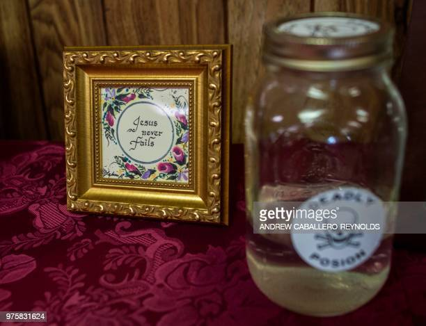 A bottle of strychnine is seen before a Pentecostal serpent handlers service at the House of the Lord Jesus church in Squire West Virginia on May 26...