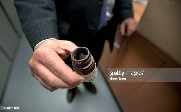 A bottle of synthetic psilocybin is displayed for a photograph at the Bluestone Center for Clinical Research at the New York University College of...