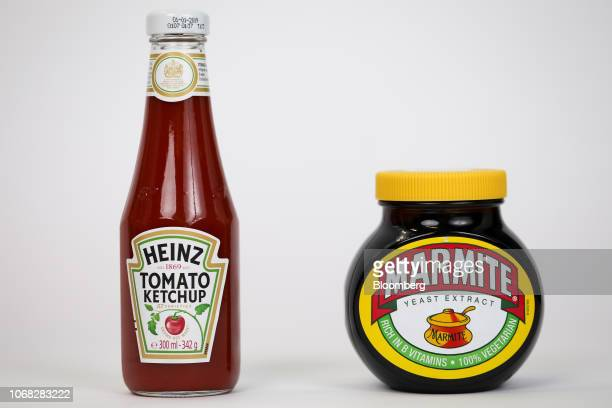 A bottle of tomato ketchup manufactured by Kraft Heinz Co left stands next to a jar of Marmite manufactured by Unilever NV in this arranged...