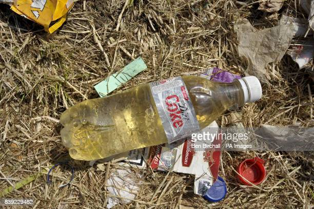 A bottle of urine left behind as the cleanup operation begins after the Glastonbury Festival at Worthy farm Somerset