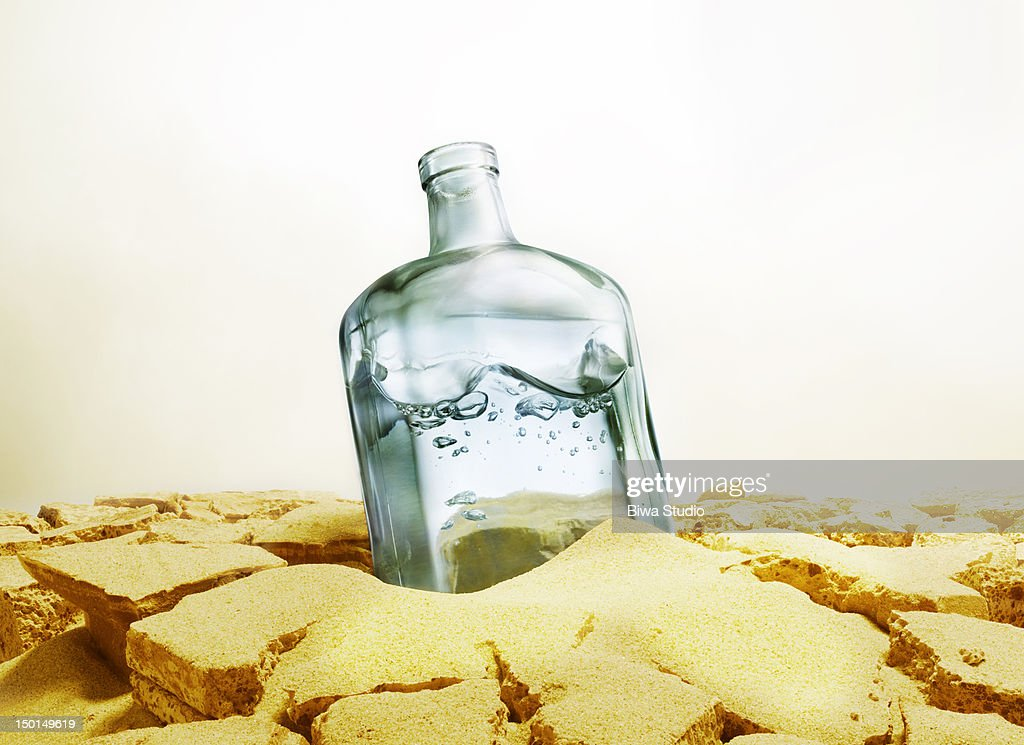 Bottle of water sitting in : Stock Photo