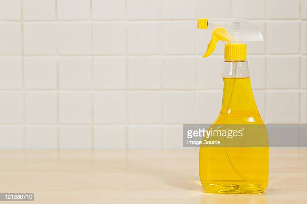 Bottle of yellow cleaning fluid