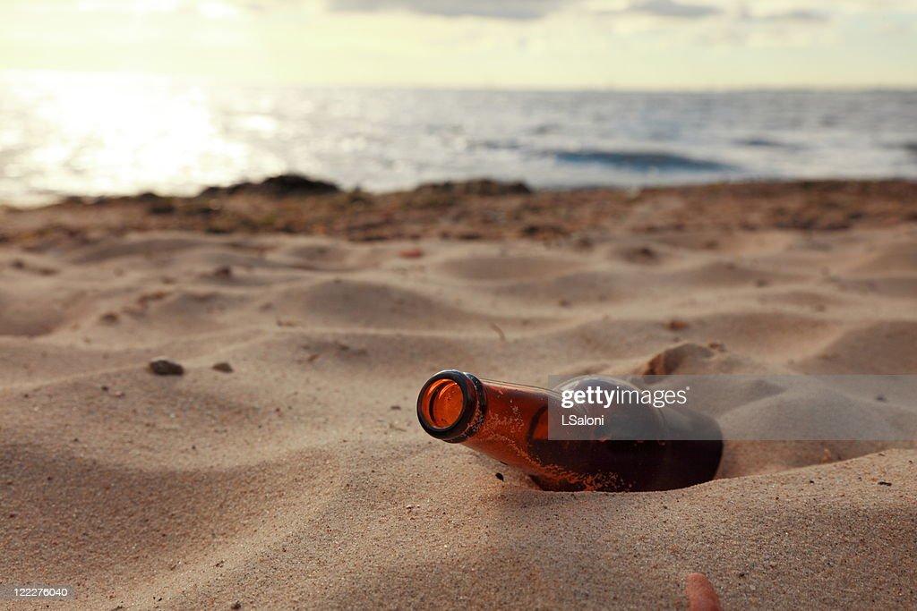 bottle on beach : Stock Photo