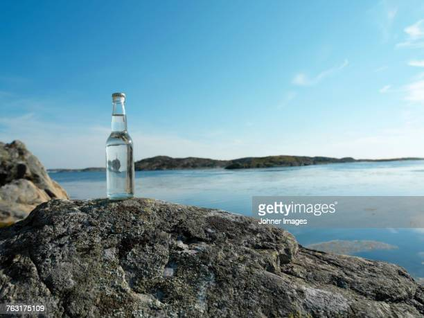 Bottle on rock at sea