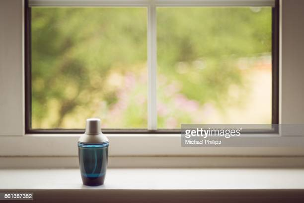 bottle on window - window sill stock pictures, royalty-free photos & images