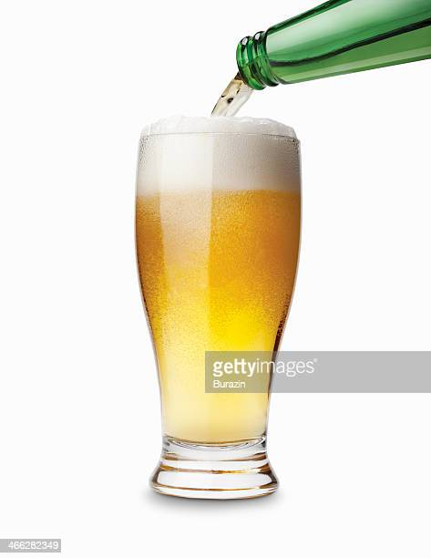 Bottle pouring a glass of beer