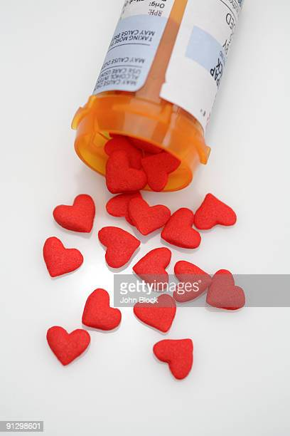 bottle with heart shaped pills