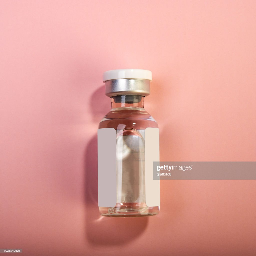 bottle with medical injection on a pink background. : Stock Photo