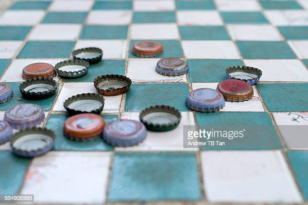 Bottlecap checkers played outdoors