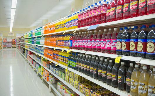 Bottled juice on supermarket shelves - gettyimageskorea