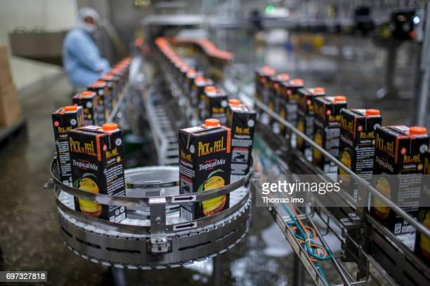 Bottled Tetra Paks with fruit juice are transported over a conveyor belt Production of juice at beverage manufacturer Kevian Kenya Ltd on May 18 2017...