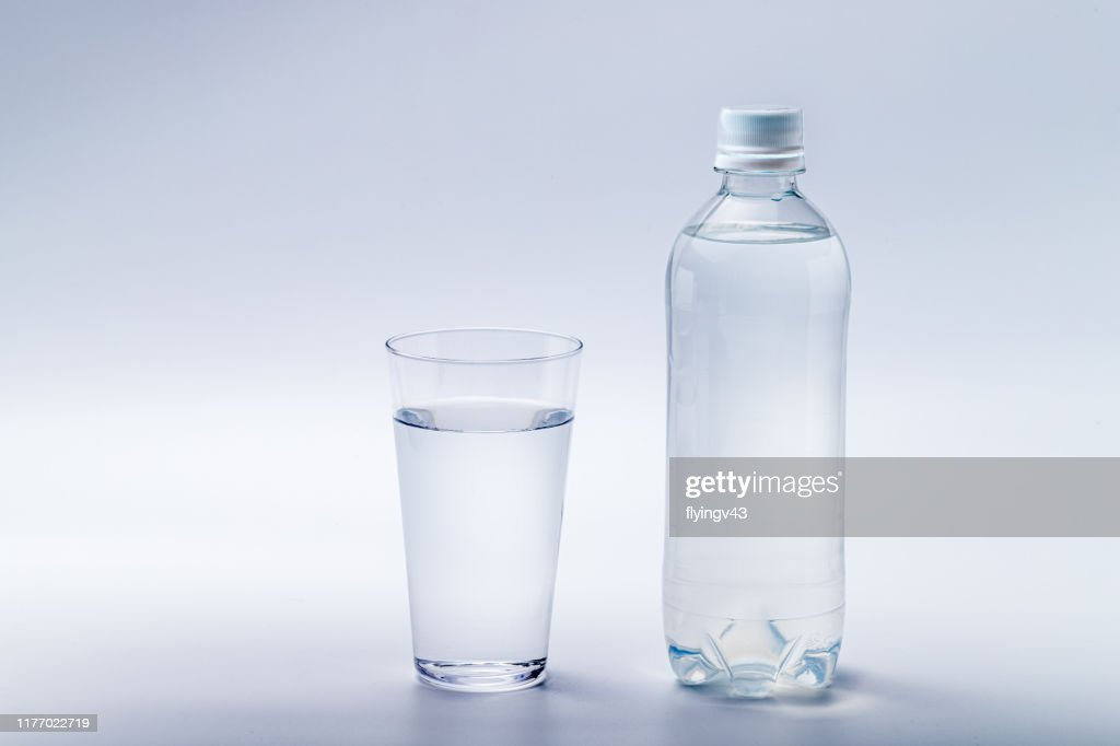 Bottled water and glass water : Stock Photo