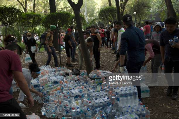Bottled water is distributed after a magnitude 71 earthquake struck on September 19 2017 in Mexico City Mexico The earthquake caused multiple...