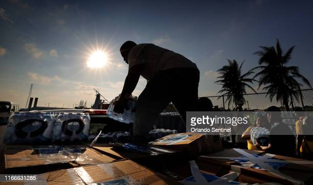 Bottled water is loaded onto trucks after arriving from the Royal Caribbean's Mariner of the Seas ship in Freeport Bahamas on Saturday Sept 7 2019