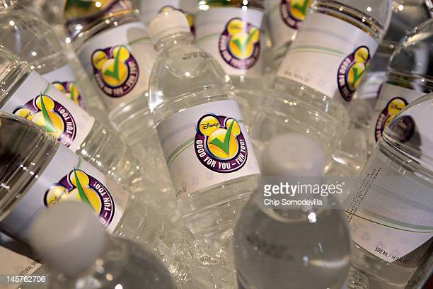 Bottled water with the new logo Mickey Mouse ears and a check mark is displayed during an event introducing The Walt Disney Companys new Magic of...
