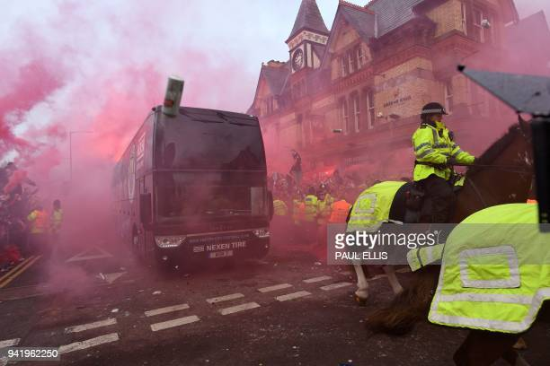 Bottles and cans are thrown at the bus as Manchester City players arrive at the stadium before the UEFA Champions League first leg quarterfinal...