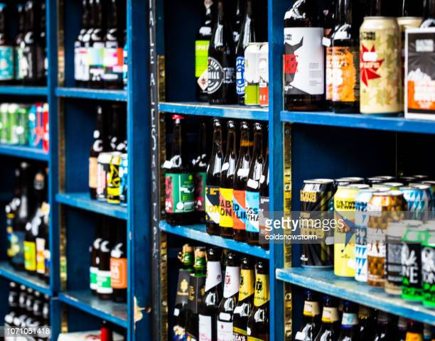 bottles and cans of real ale and craft beer for sale at food and drink market - the brewery london stock photos and pictures