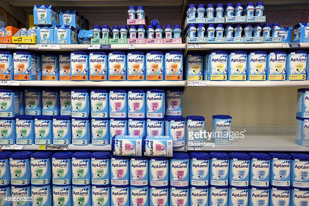 Bottles and cartons of Aptamil formula baby milk manufactured by Danone SA stand at the Tesco Basildon Pitsea Extra supermarket operated by Tesco Plc...