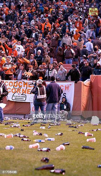 Bottles and debris litter the field at Cleveland Browns Stadium in Cleveland Ohio as frustrated Brown fans defy a referee call during the Cleveland...