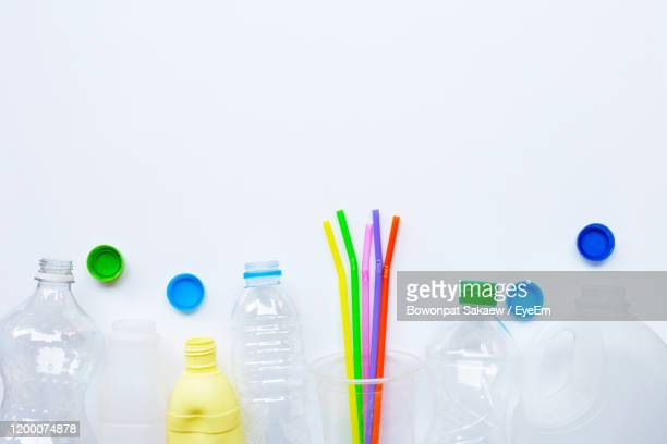 bottles and drinking straws on white background - cap stock pictures, royalty-free photos & images
