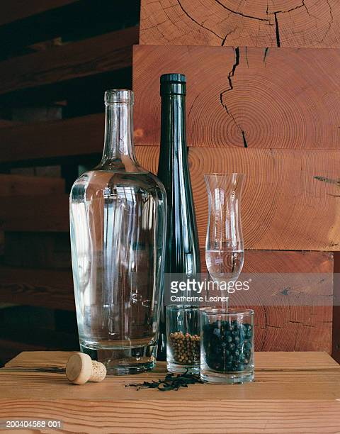 Bottles and glasses with gin and spices