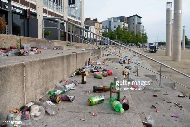 Bottles and rubbish left behind at Roald Dahl Plass after a late-night lockdown party on June 26, 2020 in Cardiff, United Kingdom. The First Minister...