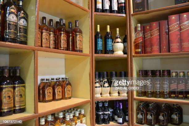 Bottles are seen in a shop in Iraq's second city of Mosul on October 17 2018 Rows of yellowlabeled whiskey bottles sit alongside imported French...