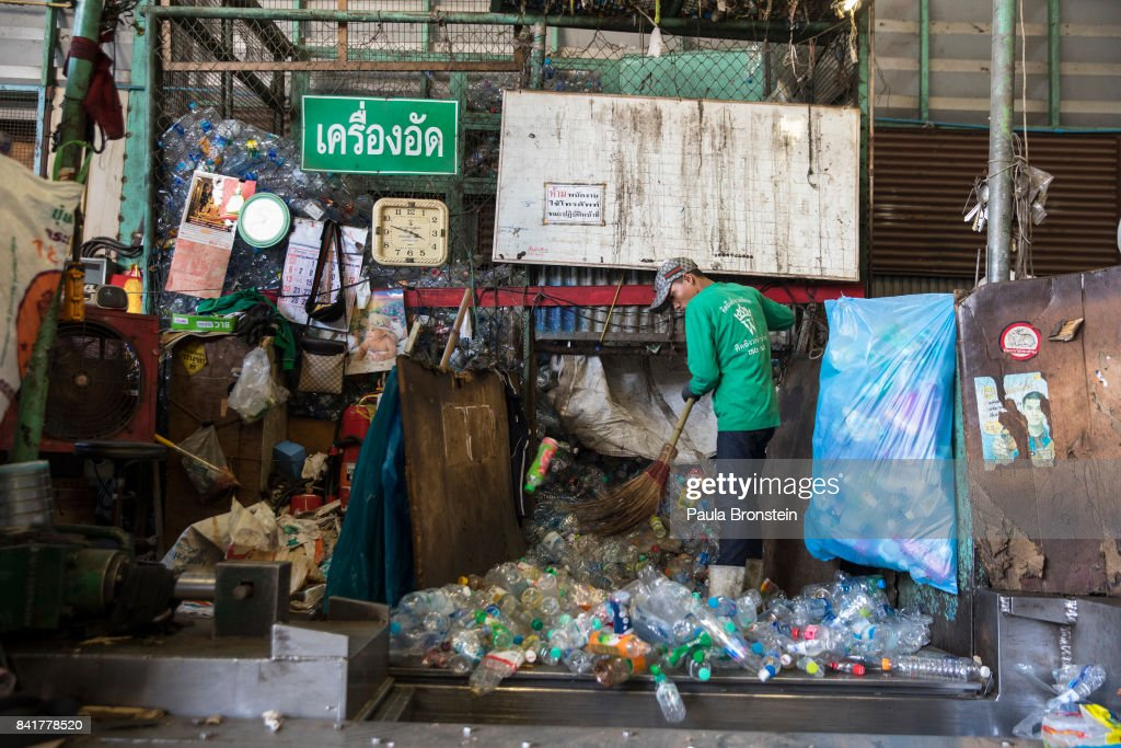 Bottles are swept into a compressor at the Wongpanit Suvarnabhumi recycle collection center on September 1, 2017 in Bangkok, Thailand. Plastic bottles can be recycled into Polyethylene Terephthalate (PET) bottle flakes and post consumer recycle (PCR) Resins and Fibers for the textile and Home furnishing market. Many plastic items like shopping bags, and food wrapping tend to be used for short periods before being discarded. A recent study stated that Thailand along with China, Indonesia, the Philippines and Vietnam are on the list of the world's top-five plastic polluters. Cleaning up plastic pollution in Thailand is a challenge due to cultural, infrastructure and environmental obstacles.