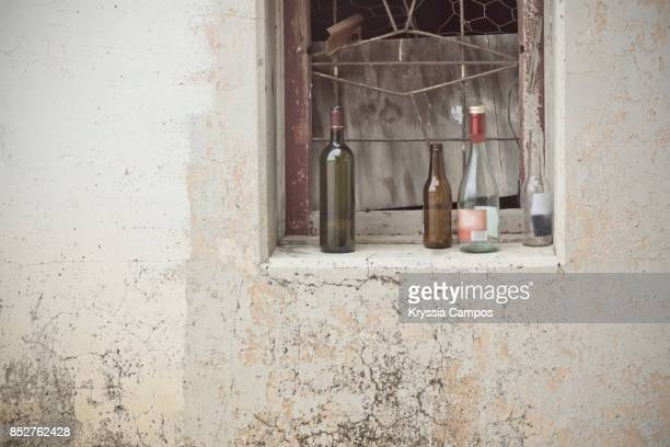 Bottles at Decayed Window in an Abandoned Farmhouse
