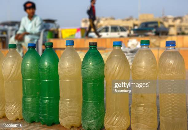 Bottles filled with water for washing feet stand at Clifton Beach in Karachi Pakistan on Sunday Dec 23 2018 Women and children walk miles each day in...
