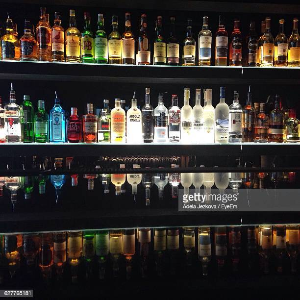 Bottles In Shelf At The Bar