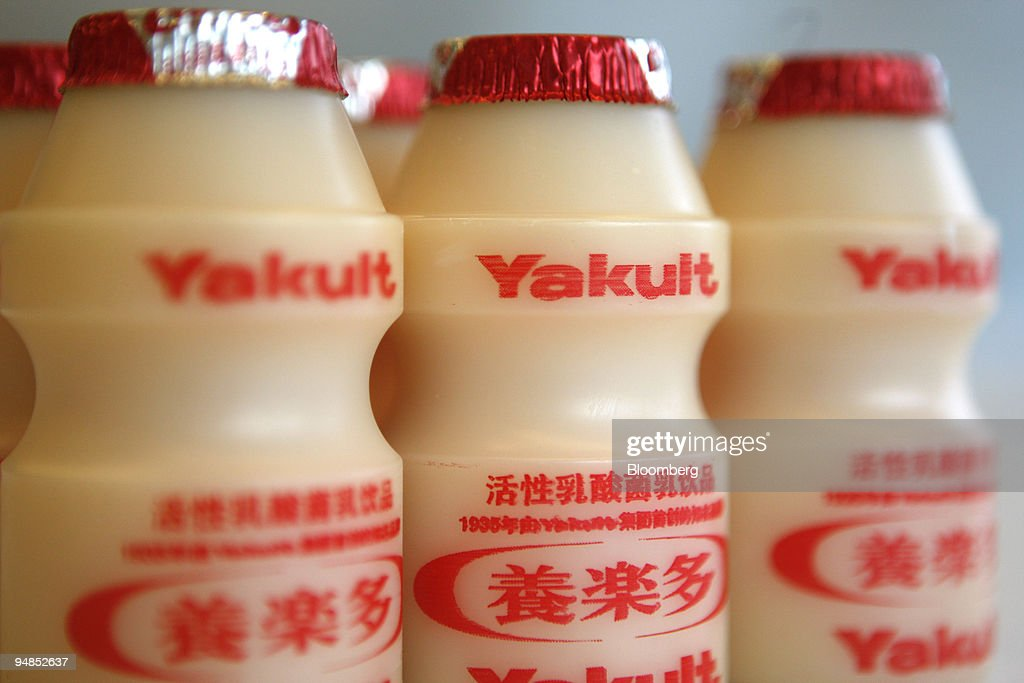 Bottles of a fermented-milk drink manufactured by Yakult Honsha Co. are are arranged for a photograph in Beijing, China, on Friday, Nov. 14, 2008. Yakult Honsha Co. plunged the most in almost nine years in Tokyo trading after the maker of Japan's best-selling fermented-milk drink cut its profit forecast on weak sales.