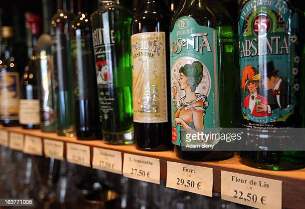 Bottles of absinthe sit on a shelf for sale at the Absinth Depot shop on March 15 2013 in Berlin Germany The highly alcoholic drink absinthe was...