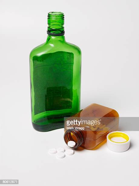 Bottles of alcohol and pills