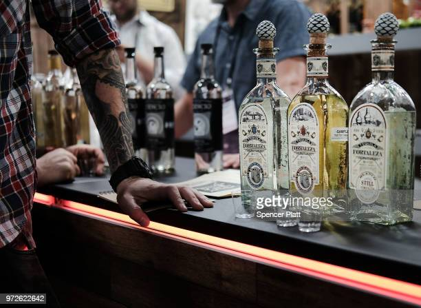 Bottles of alcohol are displayed at Bar Convent Brooklyn an international bar beverage trade show at the Brooklyn Expo Center on June 12 2018 in the...