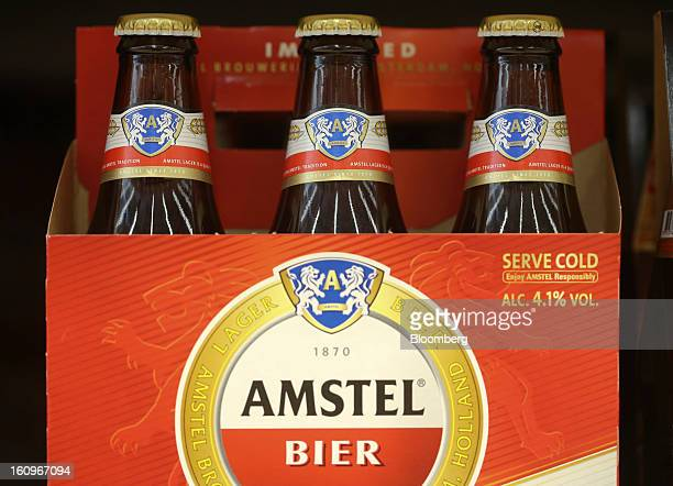 Bottles of Amstel lager beer produced by Heineken NV sit on display inside a supermarket in London UK on Friday Feb 8 2013 Britain's economy will...