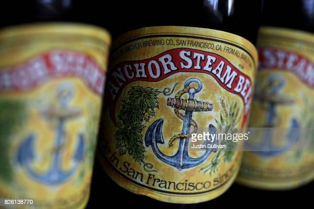 Bottles of Anchor Steam beer are displayed on August 3 2017 in San Anselmo California San Francisco based Anchor Brewing announced plans to sell to...