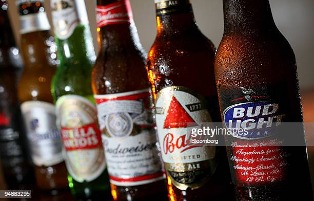 Bottles of Anheuser-Busch's Bud Light, Budweiser and Budweiser Select and InBev NV's Bass, Stella Artois, and Hoegarden are arranged for a photograph...