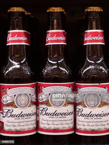 Bottles of AnheuserBusch's Budweiser beer sit on display in a New York supermarket on February 4 2003 AnheuserBusch Cos the world's largest brewer...