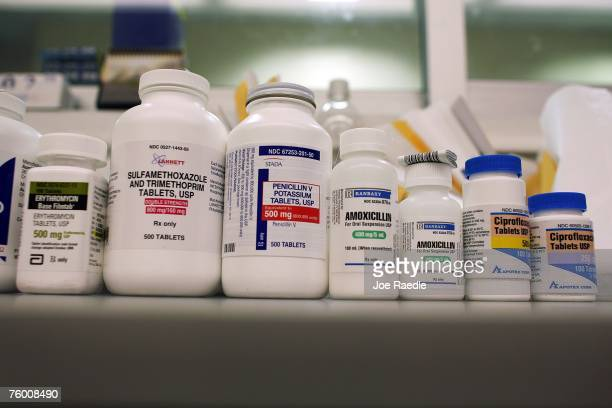 Bottles of antibiotics line a shelf at a Publix Supermarket pharmacy August 7 2007 in Miami Florida Publix has decided to start giving away seven...