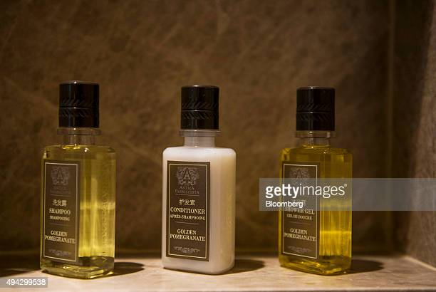 Bottles of Antica Farmacista shampoo left conditioner center and shower gel sit inside the bathroom of a Star Premier Twin room in the Star Tower at...