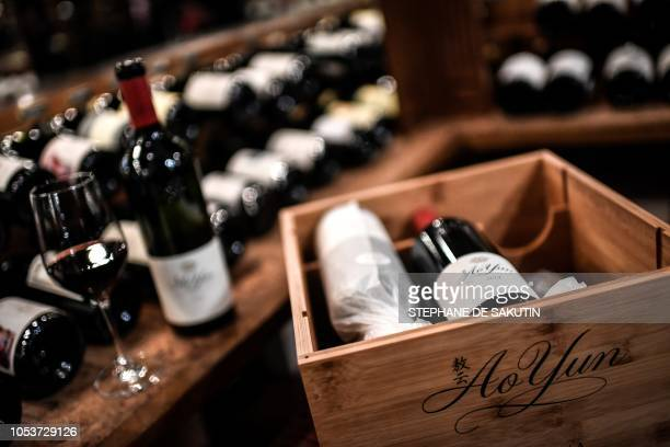Bottles of Ao Yun wine are pictured at the 'Legrand Filles et Fils' liquor store in Paris on October 26 2018 The Chinese highend wine that is Ao Yun...