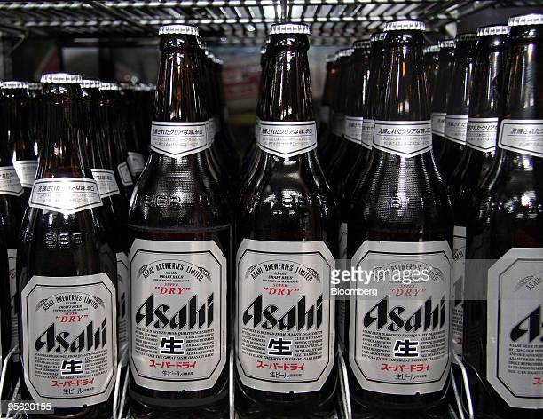 Bottles of Asahi Breweries Ltd's Super Dry beer are displayed for sale at a liquor shop in Tokyo Japan on Wednesday Jan 6 2010 Carlsberg A/S agreed...