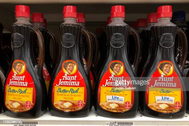 Bottles of Aunt Jemima pancake syrup are displayed on a shelf at a Safeway store on June 17 2020 in San Anselmo California Quaker Oats announced that...
