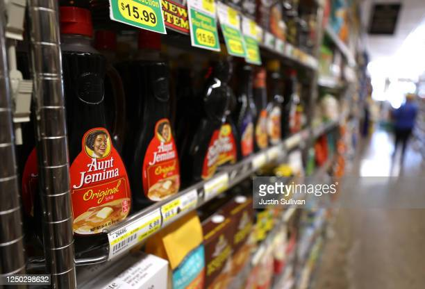 Bottles of Aunt Jemima pancake syrup are displayed on a shelf at Scotty's Market on June 17 2020 in San Rafael California Quaker Oats announced that...