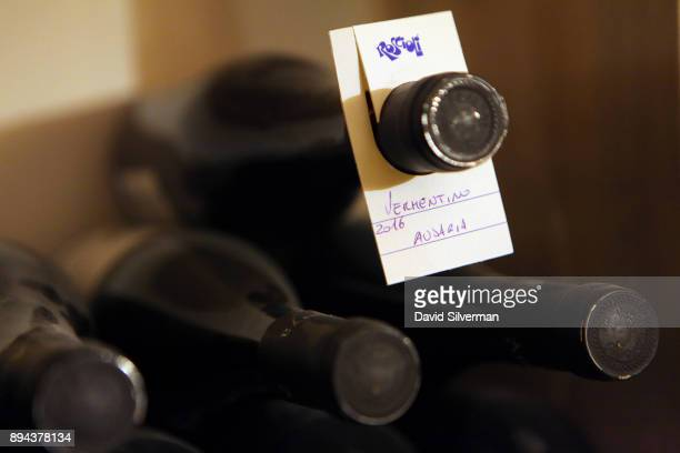 Bottles of Austrian Vermentino white wine are labelled and stored in the wine cellar at the Rimessa Roscioli restaurant on December 8 2017 in Rome...