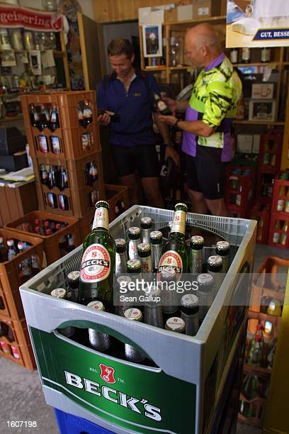 Bottles of Beck''s beer stand on display August 6 2001 in a village store in southern Bavaria Germany The Belgian beer giant Interbrew announced...