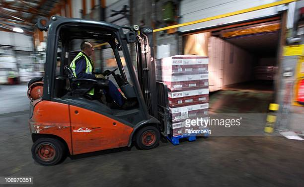 Bottles of Beefeater gin are driven on to a truck at the Pernod Ricard SA bottling plant in Dumbarton UK on Friday Nov 19 2010 Pernod Ricard SA the...